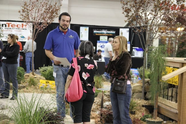 An exhibitor talks to attendees at a previous Oklahoma City Spring Remodel & Landscape Show. The 2021 edition is scheduled for Jan. 29-31 at The Pavilion at the OKC Fairgrounds. [PHOTO PROVIDED/L&L EXHIBITION MANAGEMENT INC.]