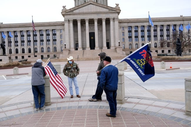 A small group of Trump supporters gathered at the Oklahoma Capitol during the inauguration of Joe Biden on Wednesday. [Doug Hoke/The Oklahoman]
