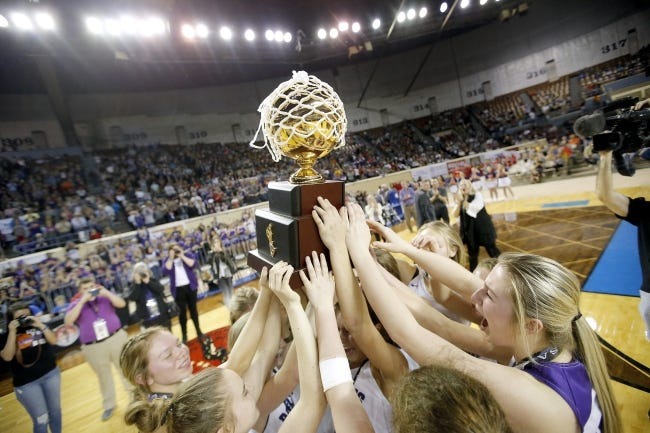 Hydro-Eakly celebrates with the gold ball trophy after winning the Class A girls basketball state title at Jim Norick Arena on March 7, 2020. [Sarah Phipps/The Oklahoman]