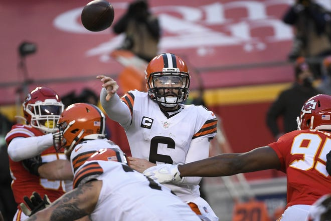 Browns quarterback Baker Mayfield (6) throws under pressure from the Chiefs during a 22-17 playoff loss last Sunday in Kansas City, Mo. [AP Photo/Reed Hoffmann]