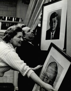 President John F. Kennedy's photo replaces the picture of former President Dwight D. Eisenhower at the Oklahoma state Capitol. After Kennedy is inaugurated as the new leader of the United States, Oklahoma House Speaker J.D. McCarty and his secretary, LaRuth White, update the presidential portrait hanging in the state House of Representatives chamber. This photo was published 60 years ago on Jan. 21, 1961, in The Daily Oklahoman. [JOHN GUMM/THE OKLAHOMAN ARCHIVES]