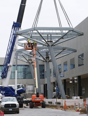 Louvered shade structures, somewhat similar to trees, that will create a virtual canopy over the street are now under construction on SW 4 between the Convention Center and the Omni Hotel. [DOUG HOKE/THE OKLAHOMAN]