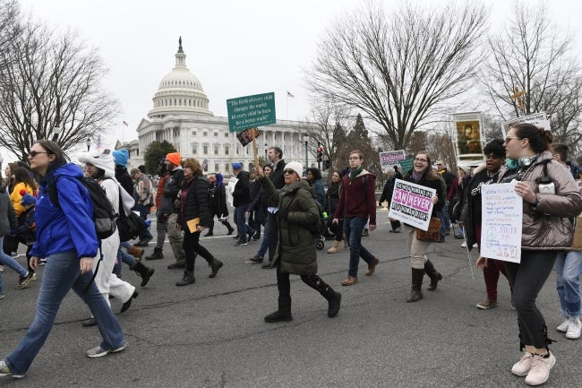"Anti-abortion activists participate in last year's ""March for Life"" rally near Capitol Hill in Washington. [AP Photo/Susan Walsh]"