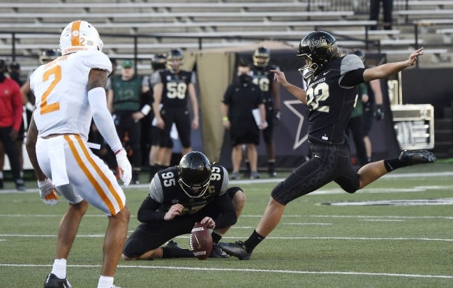 Vanderbilt place kicker Sarah Fuller (32) kicks an extra point during the first quarter of a game against Tennessee on Dec. 12 in Nashville. [George Walker IV/The Tennessean]