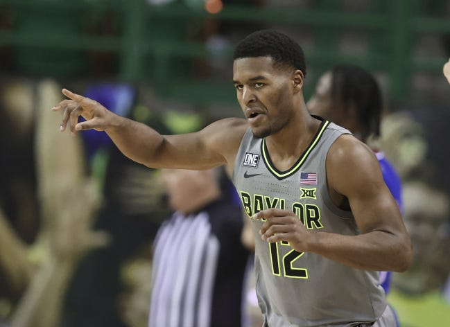Baylor guard Jared Butler reacts to this 3-pointer against Kansas in the first half on Monday in Waco, Texas. [Rod Aydelotte/Waco Tribune Herald via AP]
