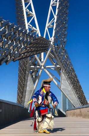 """Sgt. Denny MedicineBird, a Cheyenne & Arapaho and Kiow dancer from Jones, dances across the Skydance Bridge as part of the """"Celebrating America"""" primetime inaugural special that aired Wednesday. [Photo provided]"""