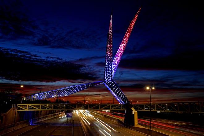 The Skydance Bridge is illuminated in red, white and blue on President Joe Biden's inauguration day. The pedestrian bridge crosses Interstate 40 in Scissortail Park near downtown Oklahoma City. [Bryan Terry/The Oklahoman]
