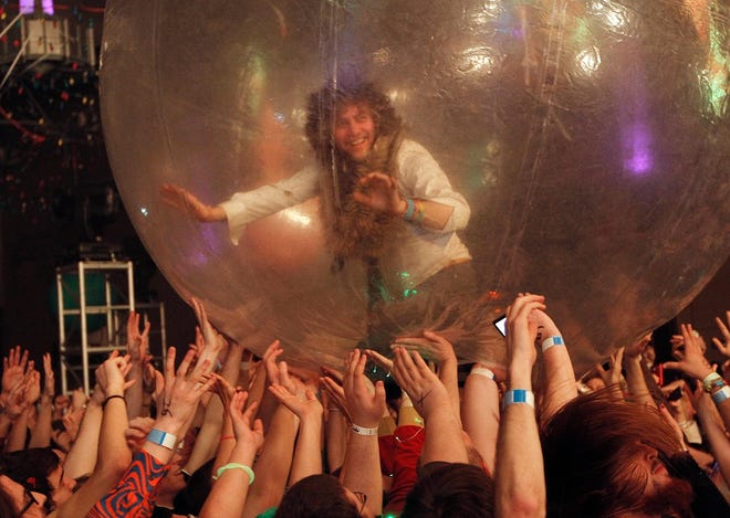 """Wayne Coyne, of the Flaming Lips, rolls around the crowd in his """"Space Bubble"""" during the Flaming Lips New's Year's Freak Out at the Coca Cola Event Center in Oklahoma City, Saturday, Dec. 31, 2011. [The Oklahoman Archives]"""