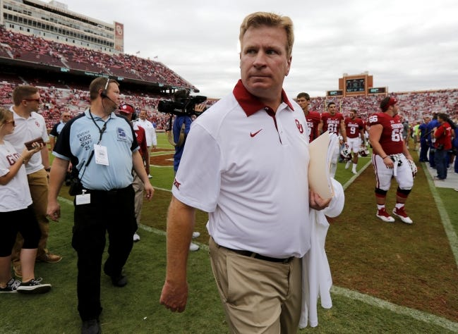 Oklahoma defensive coordinator Mike Stoops walks off the field after a 52-38 win against Tulsa on Sept. 19, 2015, in Norman. [Bryan Terry/The Oklahoman]