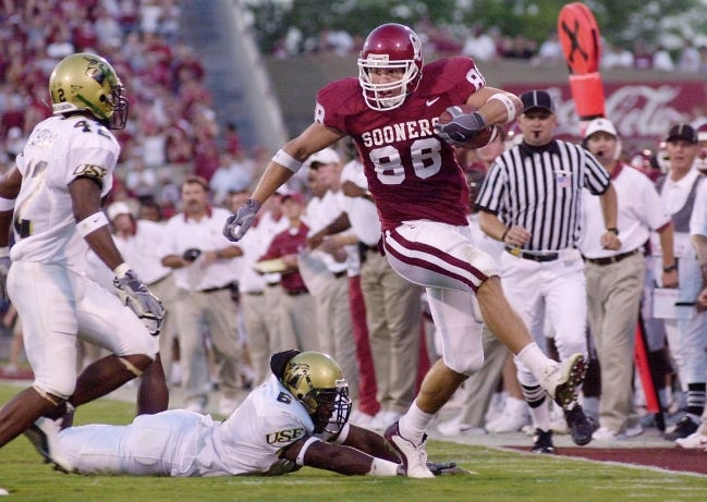 Oklahoma Sooner Trent Smith runs past South Florida's Allynson Sheffield in a game at the University of Oklahoma's Memorial Stadium on Sept. 28, 2002. Gov. Kevin Stitt will appoint Smith, now 41, to the Oklahoma State Board of Education. [The Oklahoman Archives]