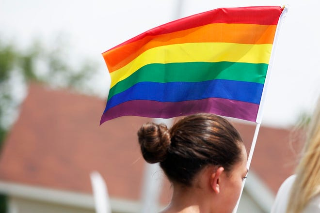 A girl waves a pride flag during the 2019 OKC Pride Parade down the 39th Street district in Oklahoma City, Oklahoma on Saturday, June 22, 2019. [The Oklahoman Archives]