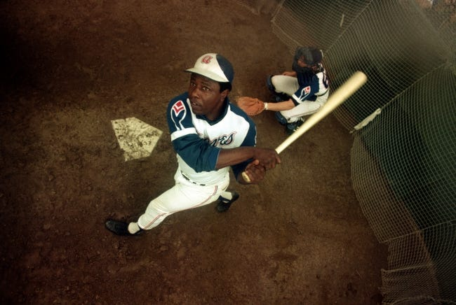 Atlanta Braves outfielder Hank Aaron swings a bat at home plate during spring training in March 1974. (AP Photo)