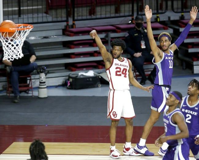 Oklahoma's Elijah Harkless, left, watches his 3-point basket go in next to Kansas State's Antonio Gordon on Tuesday. [Sarah Phipps/The Oklahoman]