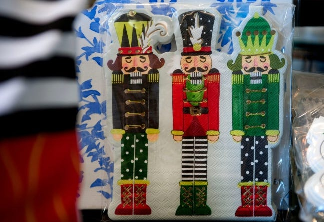 Three nutcrackers adorn paper napkins available at Palm Beach Design Masters December 2020 in Palm Beach. Pbn 121120 Nutcracker Page 05