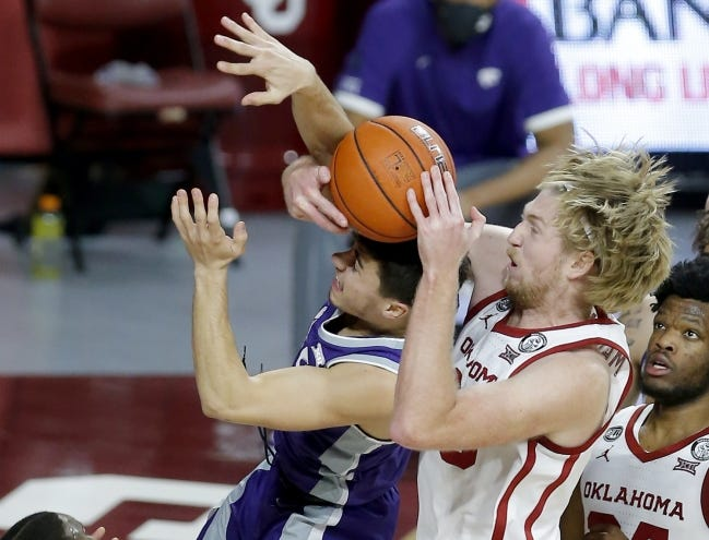 Oklahoma's Brady Manek (35) fights Kansas State's Drew Honas (14) for a rebound during the second half of the Sooners' 76-50 win Tuesday night at Lloyd Noble Center in Norman. [Sarah Phipps/The Oklahoman]