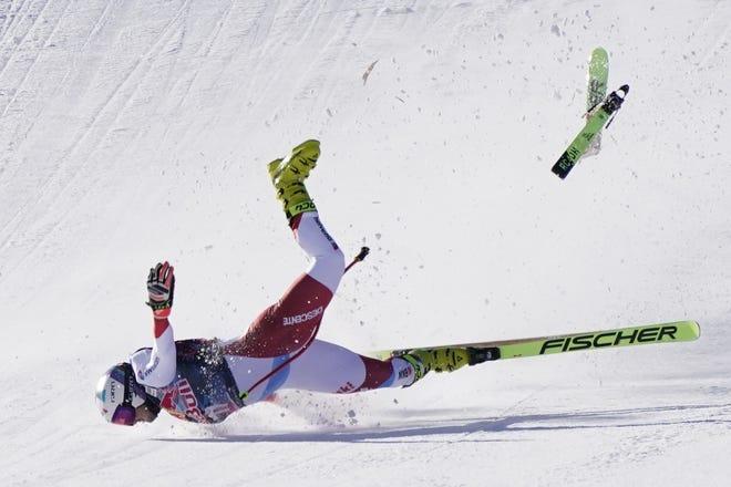 Switzerland's Urs Kryenbuehl crashes at finish line during an alpine ski, men's World Cup downhill in Kitzbuehel, Austria, on Friday. [AP Photo/Giovanni Auletta]