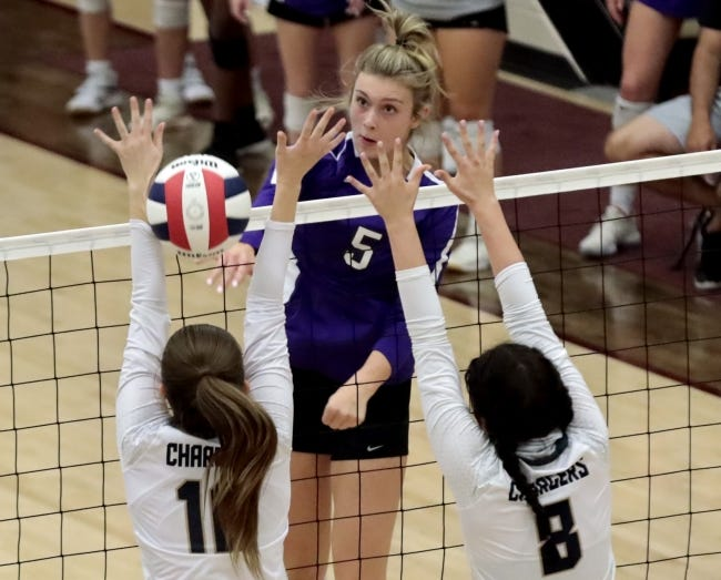 Community Christian´s Landry Braziel hits over the net against Heritage Hall in the Class 3A state volleyball championship final at Blanchard on Oct. 10, 2020. [Steve Sisney/For The Oklahoman]