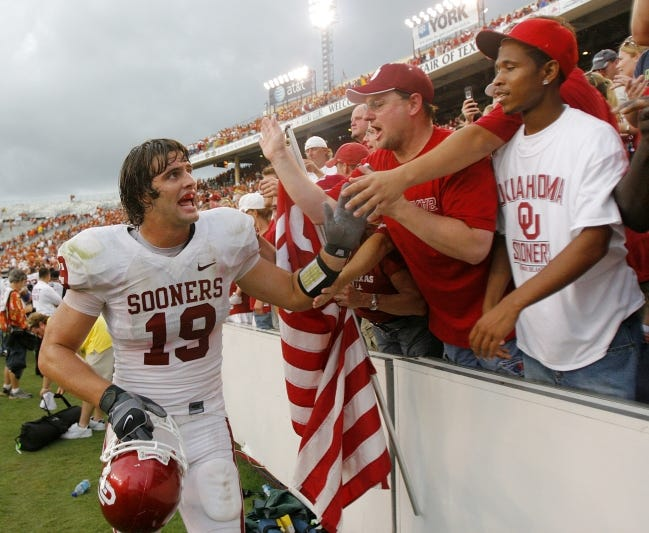 OU tight end Joe Jon Finley (19) celebrates with Sooner fans after a 28-21 win over Texas on Oct. 6, 2007, in Dallas. [CHRIS LANDSBERGER/THE OKLAHOMAN ARCHIVES]