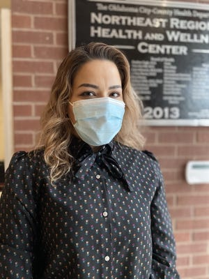 Carla Ponce stands in the lobby of the Oklahoma City-County Health Department, where she works as a bilingual community outreach specialist. [Carla Hinton/The Oklahoman]