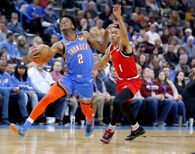 Shai Gilgeous-Alexander drives past Portland guard Anfernee Simons. The Thunder and Trail Blazers will meet Monday for the first time this season. [Sarah Phipps/The Oklahoman]