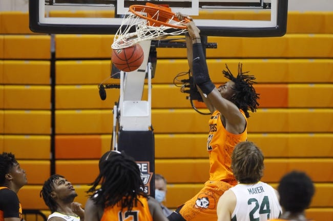 Oklahoma State's Kalib Boone dunks against Baylor on Saturday. Boone had a career-high 21 points in the loss. [Bryan Terry/The Oklahoman]