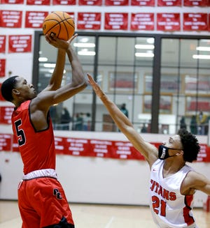 Del City's Keyondre Young had another big performance against rival Carl Albert. In this photo, Young shoots over a defender during the Titan Classic on Jan. 23, 2021. Photo by Sarah Phipps, The Oklahoman