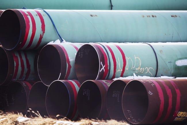 Pipes for the Keystone XL pipeline are stored in a field near Dorchester, Nebraska. [AP Photo]