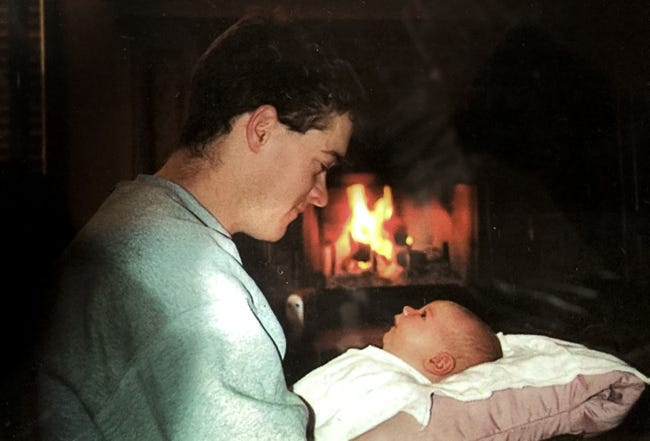 Andie Hancock was only 72 days old when her dad, Will, was killed Jan. 27, 2001, in the OSU men's basketball plane crash. This photo is among her favorites, not only because she is with her dad but also because of the fireplace in the background. She doesn't remember it being lit after her dad died. [PHOTO PROVIDED]