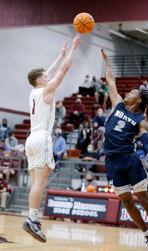 Edmond Memorial's Sean Pedulla shoots a as Edmond North's Dalante Shannon defends during the boys high school game between Edmond North and Edmond Memorial at Edmond Memorial High School in Edmond, Okla., Tuesday, Jan. 26, 2021. Photo by Sarah Phipps, The Oklahoman