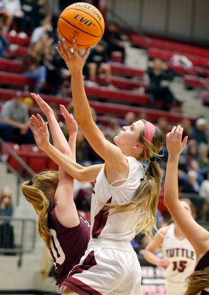 Tuttle's Madi Surber puts up a shot as Blanchard's Jalee Shannon defends during a girls high school basketball game between Tuttle and Blanchard in Tuttle, Okla., Tuesday, Jan. 26, 2021. [Bryan Terry/The Oklahoman]