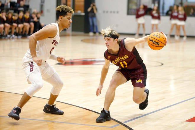Blanchard's Whit Carpenter tries to get around Tuttle's Tashon Skaggs during a boys high school basketball game between Tuttle and Blanchard in Tuttle, Okla., Tuesday, Jan. 26, 2021. [Bryan Terry/The Oklahoman]