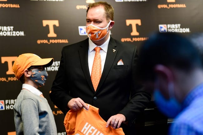 Former OU quarterback Josh Heupel holds a Volunteers jersey after his introduction Wednesday as Tennessee's new head football coach at Neyland Stadium, in Knoxville, Tenn. Heupel went 28-8 in three seasons at UCF. [Caitie McMekin/The Knoxville News-Sentinel]