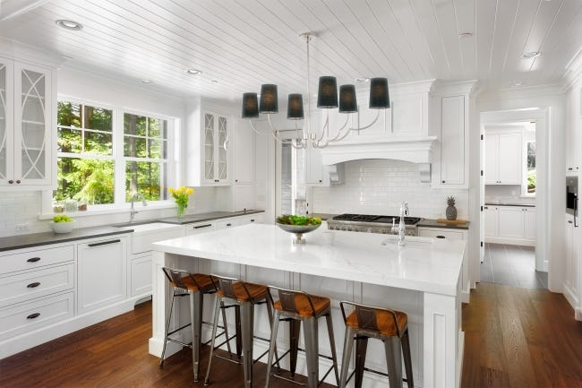 """Modern farmhouse interiors with black or dark fixtures are big on both coasts, New York interior designer Gala Magriñá says. """"We're moving away from heavy, ornate, crystal, and overly done light fixtures, to looks that are sleeker, lighter, cleaner and more modern. [PHOTO PROVIDED/KALCO LIGHTING]"""