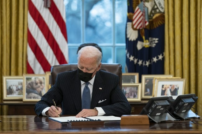 President Joe Biden signs an Executive Order reversing the Trump era ban on transgender individuals serving in military in the White House's Oval Office. On Wednesday, Biden issued a series of executive orders that impact oil and gas leasing activities involving minerals owned by the federal government. [AP Photo/Evan Vucci]