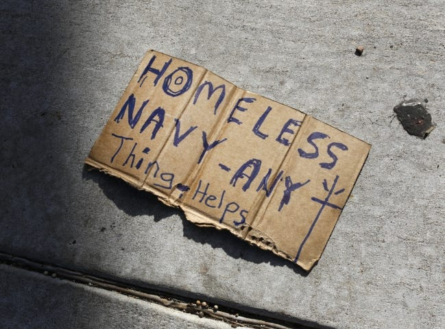A hand written note on a piece of discarded cardboard lays on a sidewalk near the intersection of NW 23 and Pennsylvania. Oklahoma City is asking the U.S. Supreme Court to look into a 2015 panhandling ordinance that an appeals court said violated the First Amendment. [Oklahoman Archive photo]