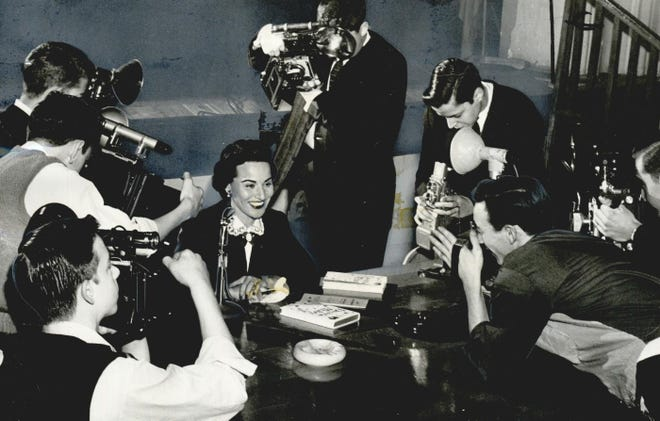 """Abigail Van Buren is the center of attention during a Jan. 28, 1958, visit to Oklahoma City. Van Buren, whose real name was Pauline Phillips, was a celebrity for her popular advice column, """"Dear Abby,"""" which was first syndicated in 1956. Metro area high school photographers seized upon the moment to capture a picture of the columnist for their school newspapers. This photo was published on that day in the Oklahoma City Times. """"Dear Abby,"""" now penned by her daughter, Jeanne Phillips, is still published in The Oklahoman. [GEORGE TAPSCOTT/THE OKLAHOMAN ARCHIVES]"""