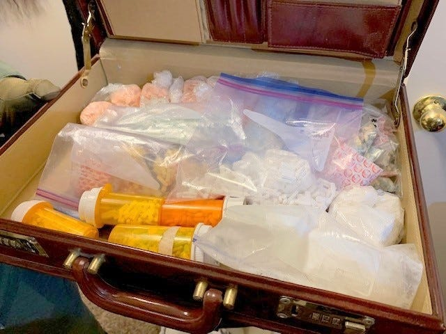 Oklahoma Bureau of Narcotics agents seized in Norman what they identified as 134 grams of cocaine, 561 grams of psilocybin mushrooms, 705 grams of marijuana, 1,278 Adderall pills, and 4,262 suspected counterfeit Xanax and Ecstasy pills. [Courtesy of OBN]