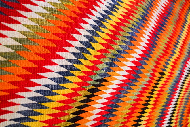 """A Transitional blanket by an unidentified Navajo artist, circa 1890-1910, at the Museum of Fine Arts' exhibition, """"Color Riot: How Color Changed Navajo Textiles,"""" on view through March in Florida. [MARTHA ASENCIO RHINE/Tampa Bay Times]"""