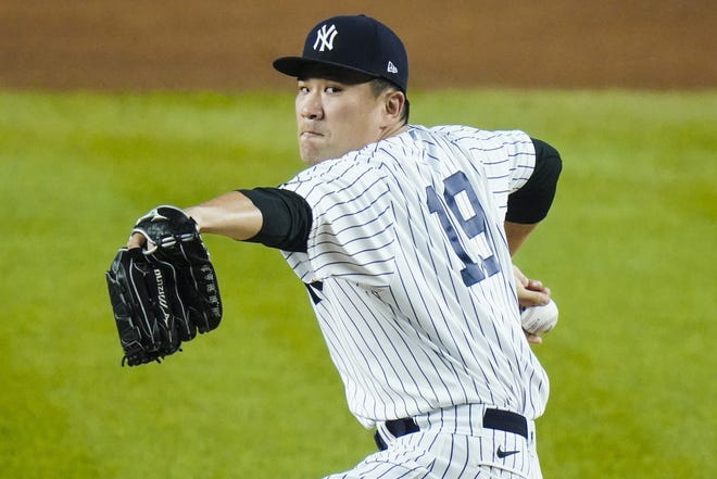 Former New York Yankees pitcher Masahiro Tanaka has signed a two-year contract with the Rakuten Eagles in Japanese baseball, the club said Thursday. [AP Photo/Frank Franklin II, File]