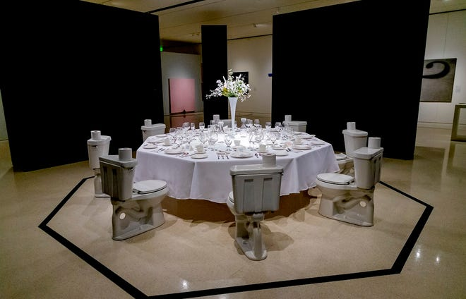 """The art installation """"Dinner for Donald"""" by artist Paul Ruscha is on display during the """"OK/LA"""" exhibit at Fred Jones Jr. Museum in Norman, Okla. on Friday, Oct. 2, 2020. The piece is dubiously dedicated to former President Donald Trump. [Chris Landsberger/The Oklahoman]"""