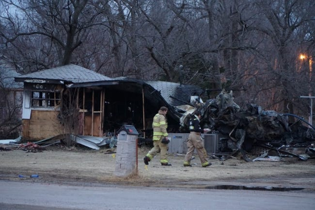 Firefighters at the scene of a housefire in Waynoka where four people died early Friday, including two firefighters. [JORDAN GREEN]