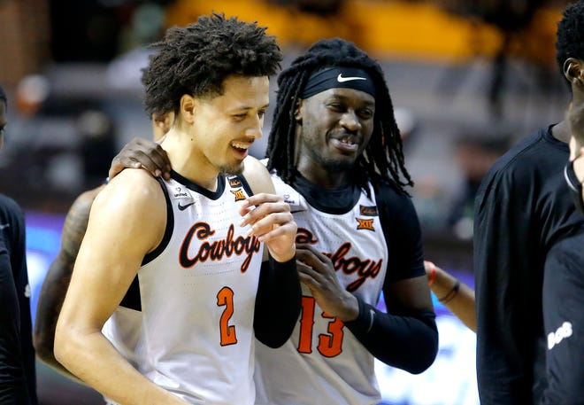 Oklahoma State's Cade Cunningham (2) and Isaac Likekele (13) celebrate during the second half of the college men's basketball game between the Oklahoma State Cowboys and the Arkansas Razorbacks at Gallagher-Iba Arena in Stillwater, Okla., Saturday, Jan. 30, 2021. Cowboys beat Arkansas 81-77. Photo by Sarah Phipps, The Oklahoman