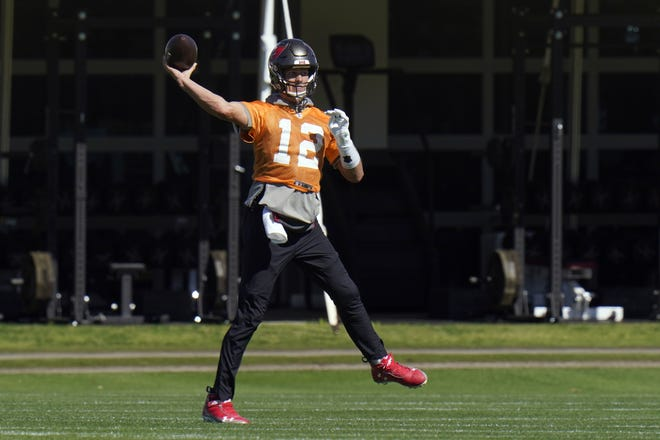 Buccaneers quarterback Tom Brady (12) throws a pass during a workout Thursday in Tampa, Fla. The Buccaneers play the Kansas City Chiefs in Super Bowl LV on Feb. 7. [AP Photo/Chris O'Meara]