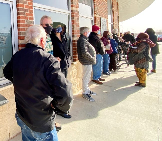 People wait in line recently to get a COVID-19 vaccination on the campus of Southwestern Oklahoma State University in Weatherford. [Doug Hoke/The Oklahoman]