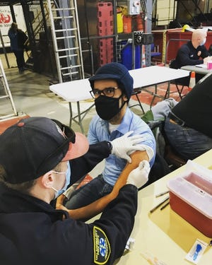 """Ward 2 Councilman James Cooper got his first COVID-19 vaccination in part, he said, to demonstrate the vaccine's safety to communities distrustful """"due specifically to a history of mistreatment from government health officials."""" [PHOTO PROVIDED]"""