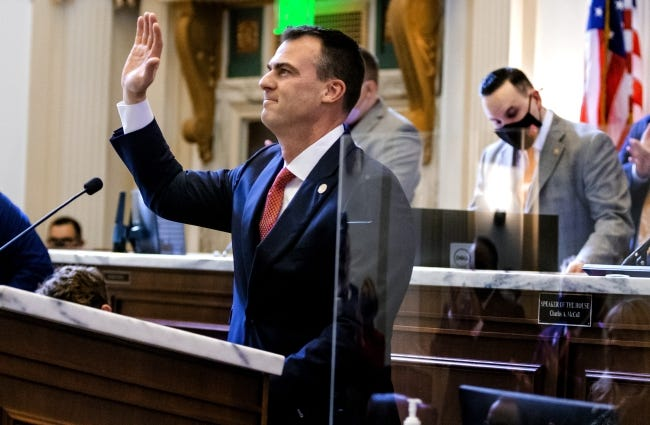 Gov. Kevin Stitt waves to members of the gallery during his State of the State address in the House of Representative's chamber at the Oklahoma state Capitol in Oklahoma City, Okla. on Monday, Feb. 1, 2021.  [Chris Landsberger/The Oklahoman]