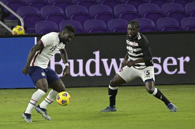 United States forward Daryl Dike (19) controls the ball in front of Trinidad and Tobago midfielder Neveal Hackshaw (15) during the second half of an international friendly Sunday in Orlando, Fla. [AP Photo/Phelan M. Ebenhack]