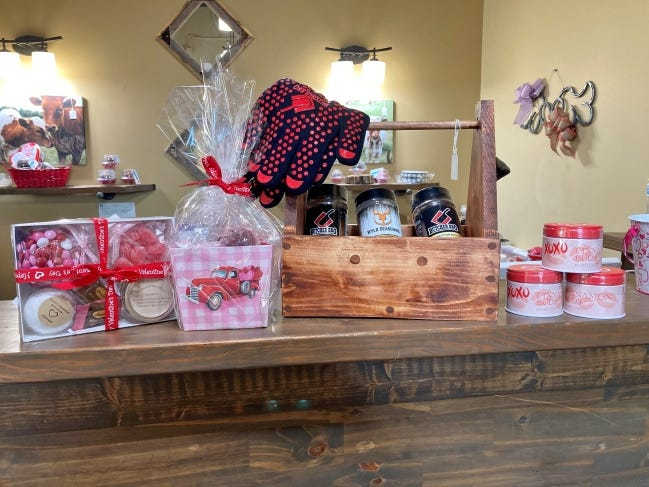 Candy, cake pops and Butcher Barbecue products are ready to fill Valentine's Day gift baskets at the Arcadia Farmers Market General Store. [PHOTO PROVIDED]