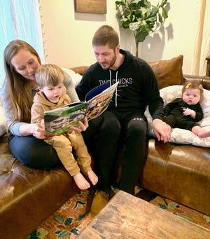 "HGTV's ""Good Bones"" star Mina Starsiak-Hawk, with her husband, Steve, reads her new children's book to son, Jack, 2, as daughter, Charlie, 4 month, listens. [PROVIDED/MINA STARSIAK-HAWK]"
