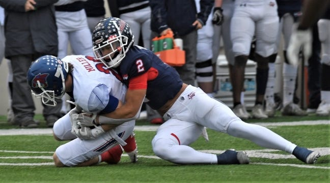 Denton Ryan's Billy Bowman Jr. tackles Cooper's Brady Miller after during a Texas high school football playoff game in 2019. Bowman will play for OU next season. [Joey D. Richards/Abilene Reporter-News]